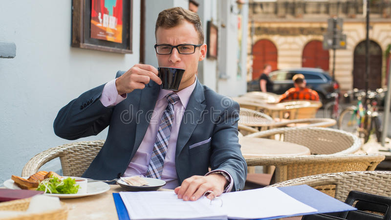 Download A Close-up Portrait Of A Businessman Having Breakfast. Royalty Free Stock Image - Image: 34061766