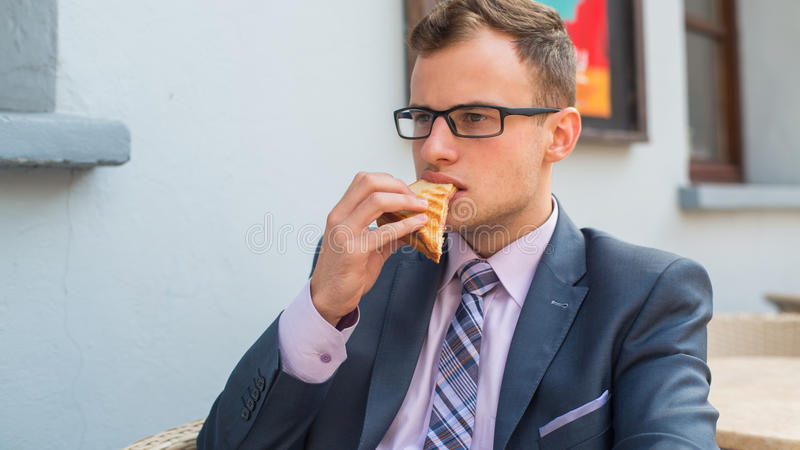 Download A Close-up Portrait Of A Businessman Having Breakfast. Stock Photo - Image: 34062422