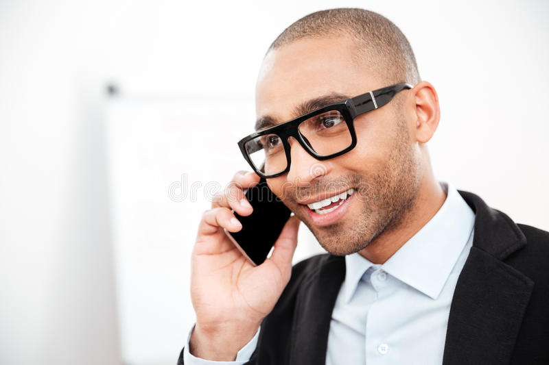 Close-up portrait of businessman talking on the mobile phone stock image