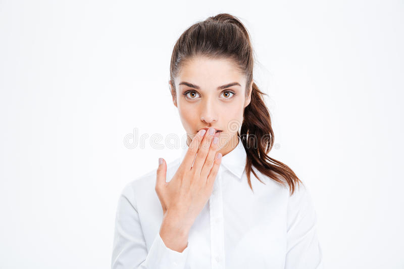 Close-up portrait of businesswoman covering her mouth with palm royalty free stock photo