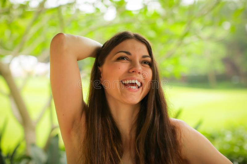 Close up portrait of carefree caucasian young woman posing with different emotions in green summer park stock images