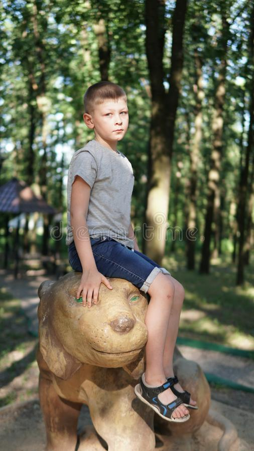 Portrait of caucasian teen boy. Funny cute teenager in summer park at day. Close up portrait of caucasian teen boy. Funny cute teenager in summer park at day on stock photography