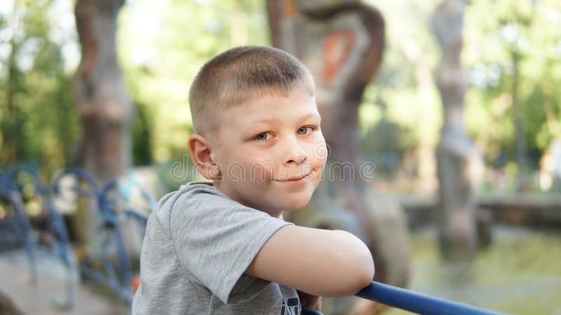 Close up portrait of caucasian teen boy. Funny teenager in summer park at day. Close up portrait of caucasian teen boy. Funny cute teenager in summer park at day royalty free stock photos