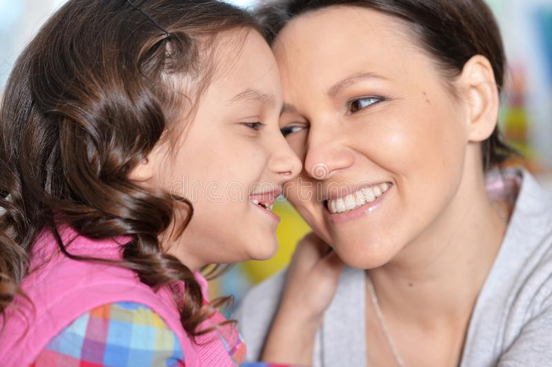 Portrait of a charming little girl with mom stock images