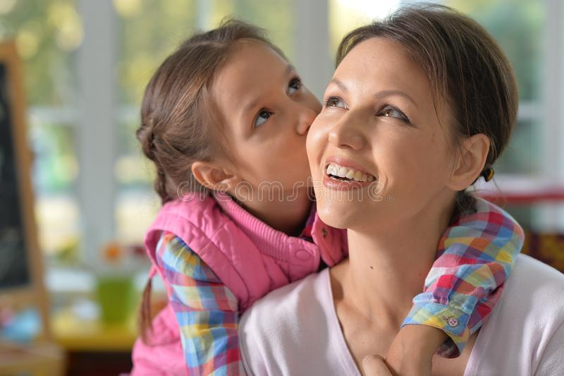 Portrait of a charming little girl with mom royalty free stock photo
