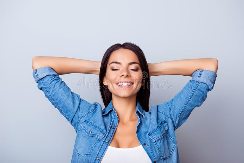 Close up portrait of charming lovely cute careless carefree beautiful with closed eyes lady having rest relax pause break leisure. Holding hands behind head stock images