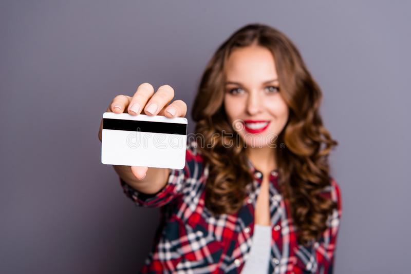 Close up portrait of cheerful beautiful amazing she her lady arm show hold advice credit card bank cool wireless line stock photography