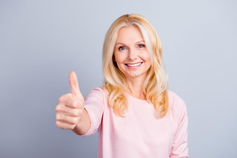 Close up portrait of cheerful glad cute cheerful lovely beautiful attractive confident pretty mature lady making demonstrating th stock images