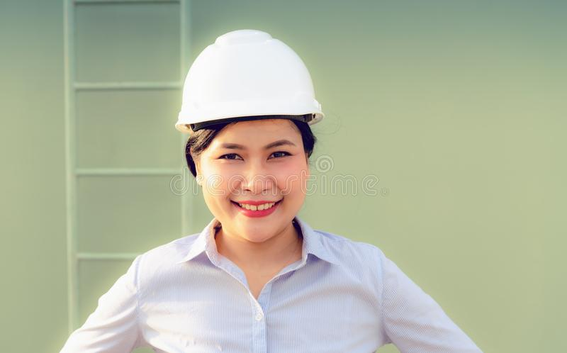 Close up portrait of civil engineer woman in front of construction site after sunset background stock photos