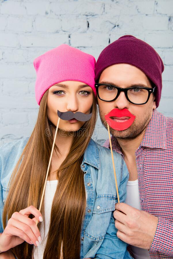 Close up portrait of comic couple in love with funny faces royalty free stock images