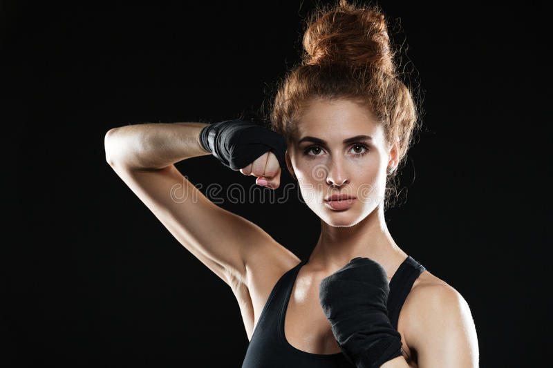 Close-up portrait of Concentrated female fighter ready to fight stock photography