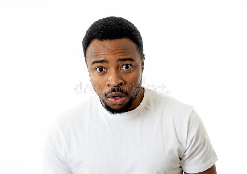Close up portrait of concern scared shocked adult man with a terrified facial expression royalty free stock photo