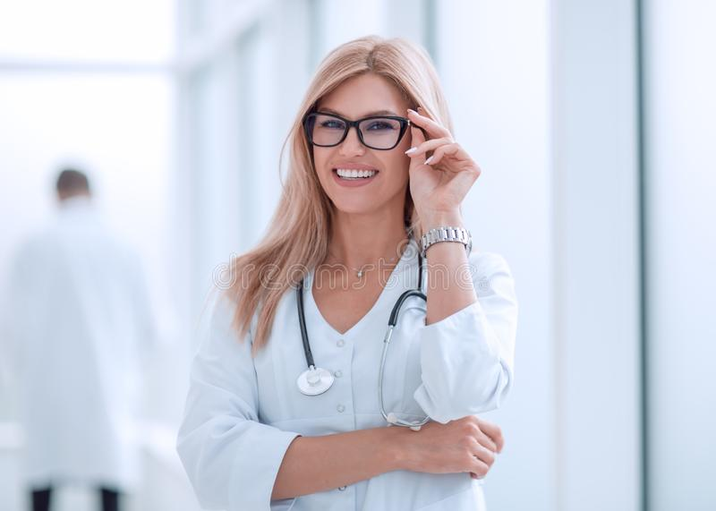 Portrait of confident female doctor with a stethoscope royalty free stock photos