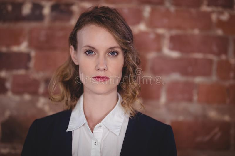 Close up portrait of confident young beautiful female editor at coffee shop stock photography