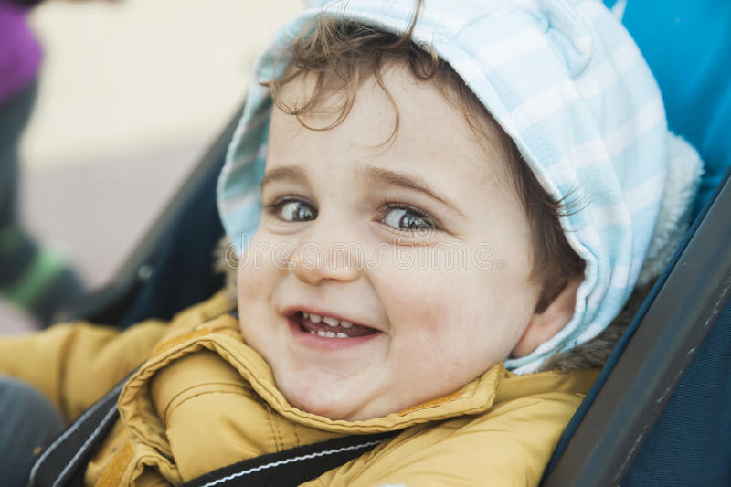 Close up portrait cute baby boy looking at the camera with big g stock photography