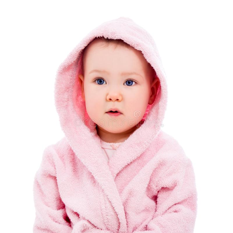 Close up portrait of cute baby girl in pink bathrobe after bath isolated on white. Background royalty free stock photography