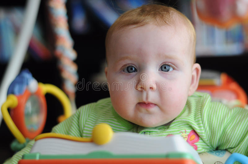 Close-up portrait of cute baby in play gym toy royalty free stock photography