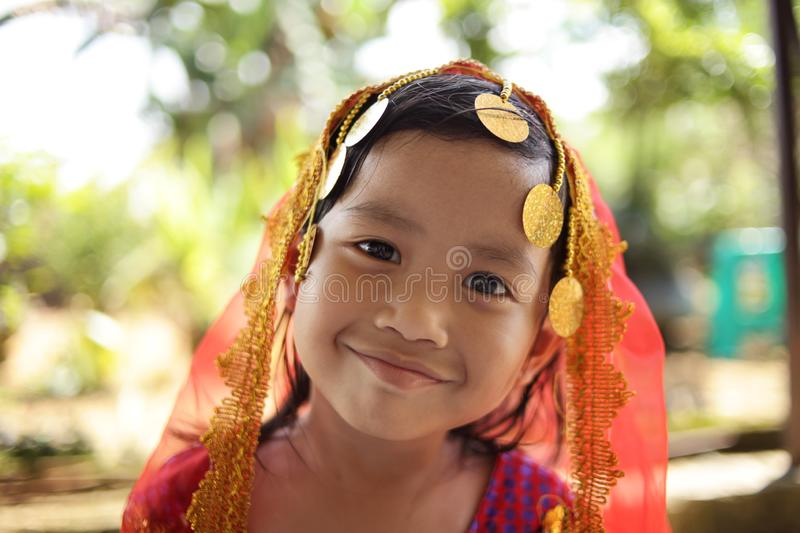 Little Indian Girl. Close up portrait of cute beautiful little Asian Indian girl with head scarf smiling indonesian malaysian thai face child female beauty hijab stock photography