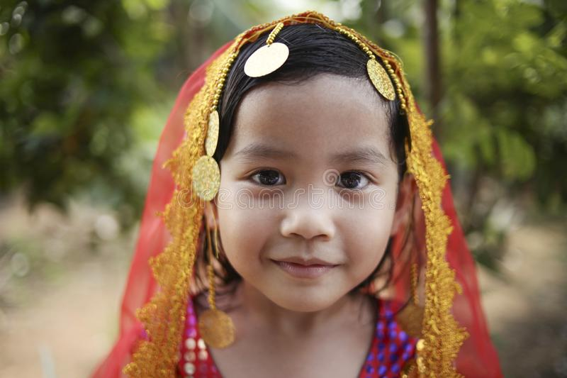 Little Indian Girl. Close up portrait of cute beautiful little Asian Indian girl with head scarf smiling indonesian malaysian thai face child female beauty hijab stock images