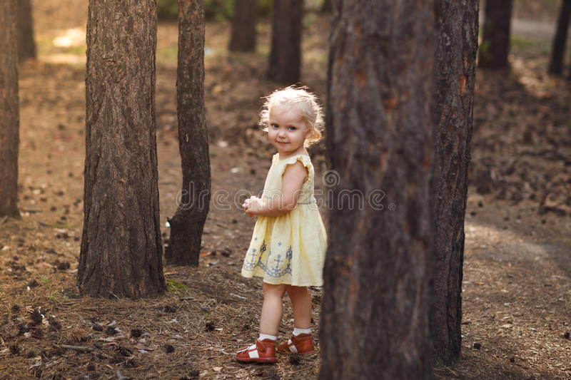 Close-up portrait of cute cheerful little girl in park stock images