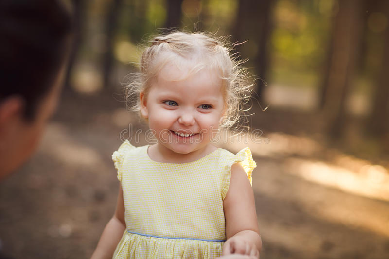 Close-up portrait of cute cheerful little girl in park royalty free stock images