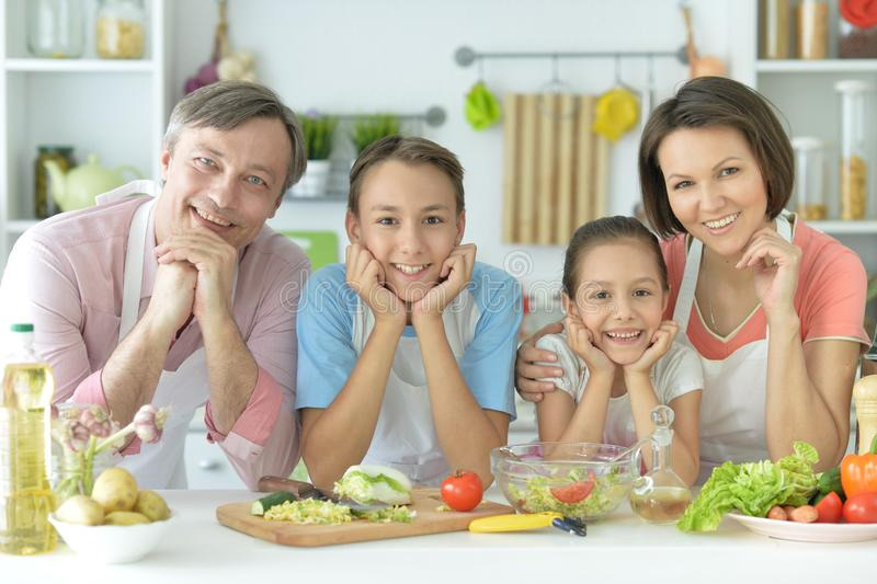 Close up portrait of cute family cooking stock photos
