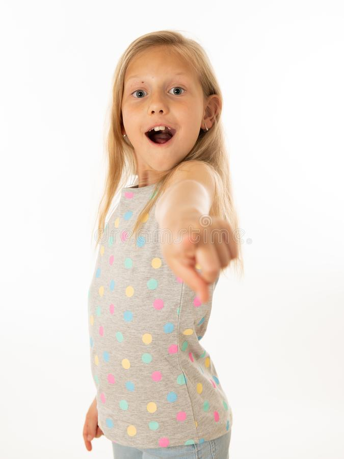 Young beautiful happy, shocked,surprised girl pointing out. Human emotions and facial expression. Close up portrait. Cute happy, excited, funny, cheerful young royalty free stock photo