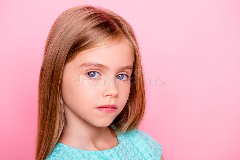 Close up portrait of cute nice lovely charming adorable beautiful confident concentrated little girl with big blue eyes, isolated royalty free stock images