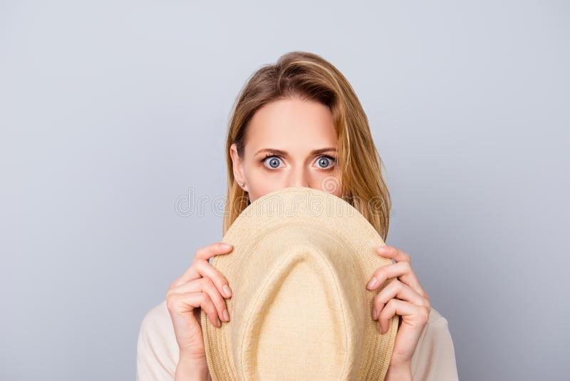 Close up portrait of cute young woman keeping silence and hiding royalty free stock photos