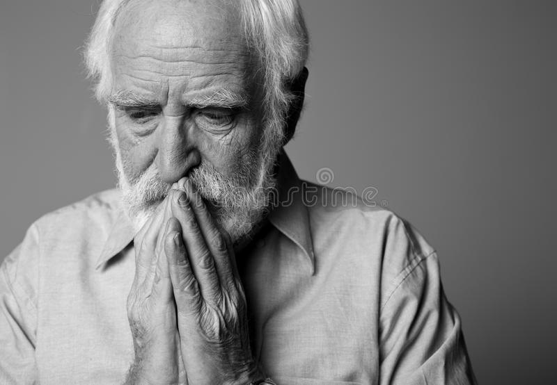 Frustrated old man closing mouth with hands royalty free stock photography