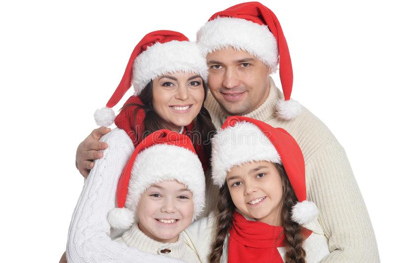 Close up portrait of family with kids in santa hats. Family with kids in Santa hats posing on white background royalty free stock images