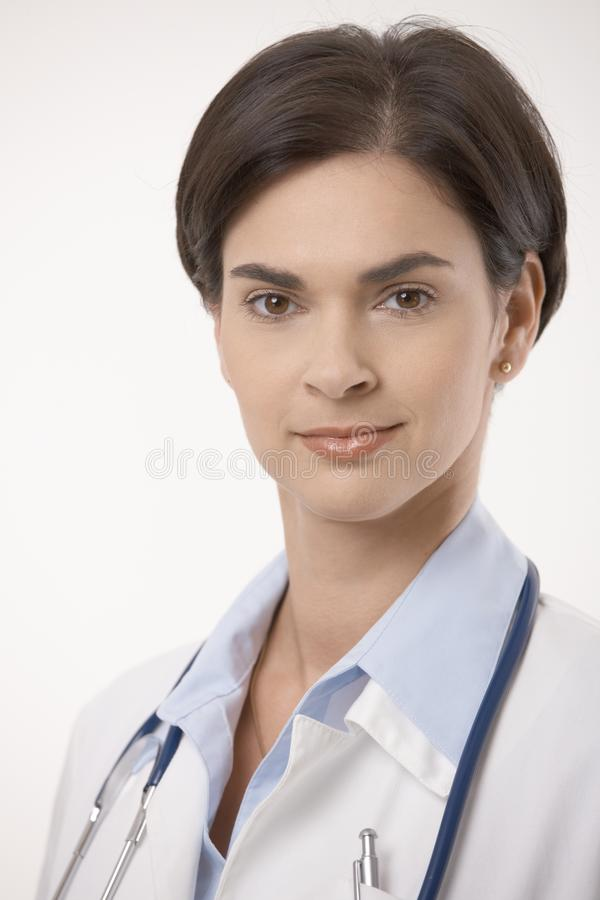Close up portrait of female doctor in lab coat. Close up portrait of female caucasian doctor in lab coat. Smiling, looking at camera, isolated on white stock photos