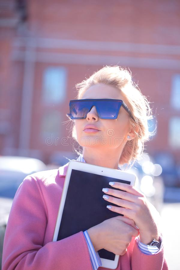 Close up portrait of a female student holding tablet stock photos
