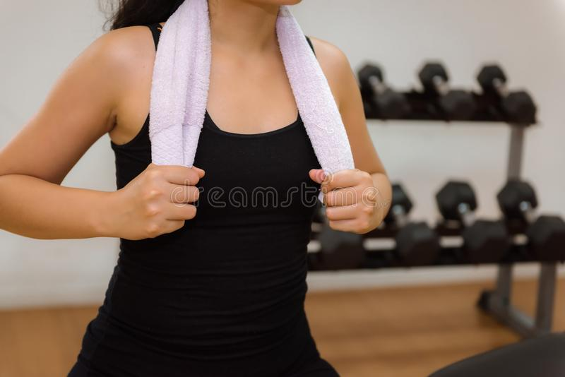 Close-up portrait of fitness woman holding towel after gym stock photo