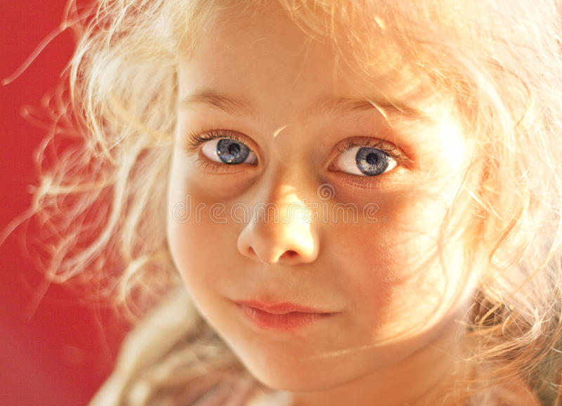Close up portrait of five years old blond child girl stock photo