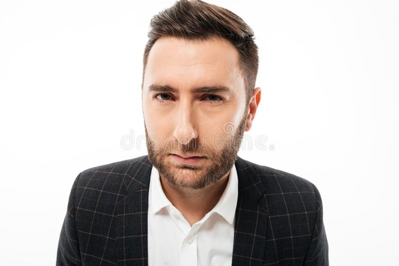 Close up portrait of frowning angry bearded man stock images