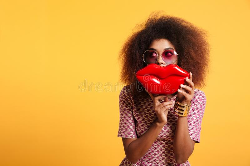 Close-up portrait of funny afro american wooman in sunglasses ho stock photo