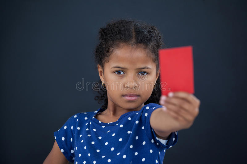 Close up portrait of girl showing red card royalty free stock photo