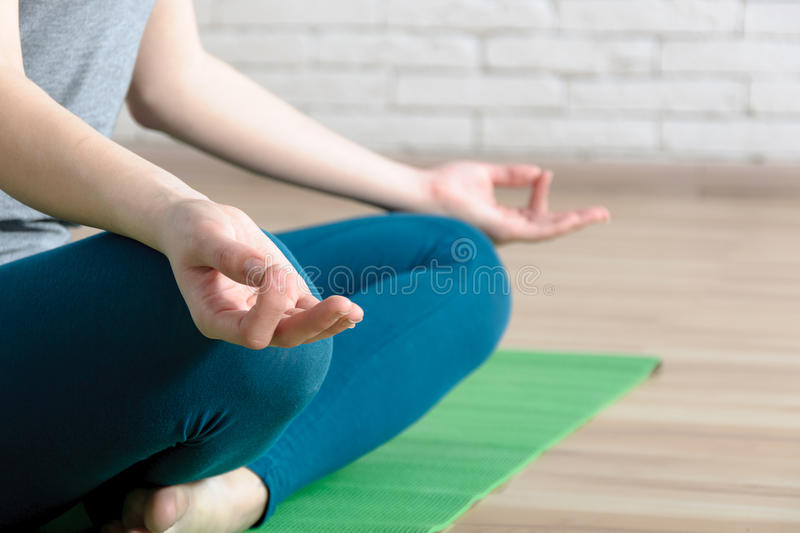 Close-up portrait of a girl who does yoga asana. royalty free stock photography