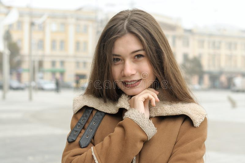 Close-up portrait of a girl who is walking around the city and s stock photo