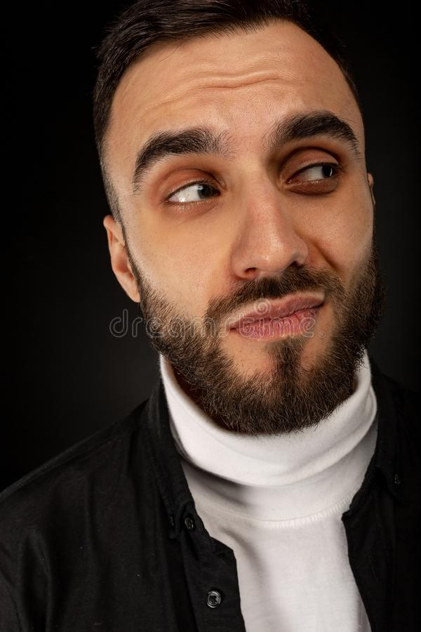 Close up portrait of handsome bearded man with sly smile stock images