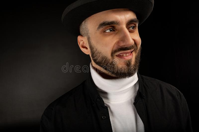 Close up portrait of handsome bearded man with sly smile stock photos