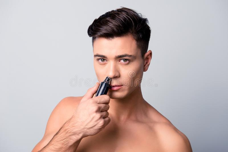 Close up portrait of handsome confident concentrated shaven guy stock photography