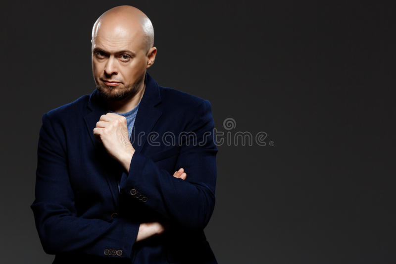 Close up portrait of handsome confident middle-aged businessman over black background. stock photo