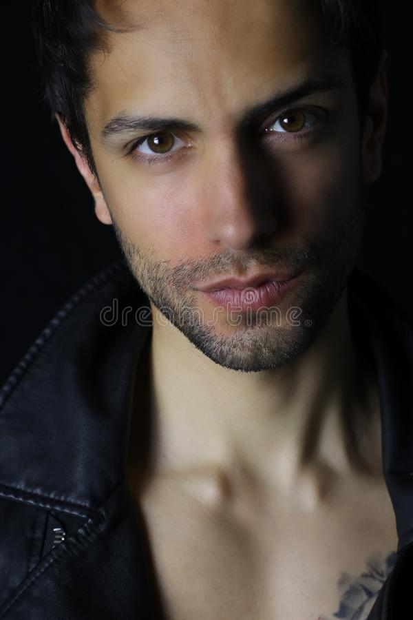 Close up portrait of an handsome man on black background royalty free stock photography