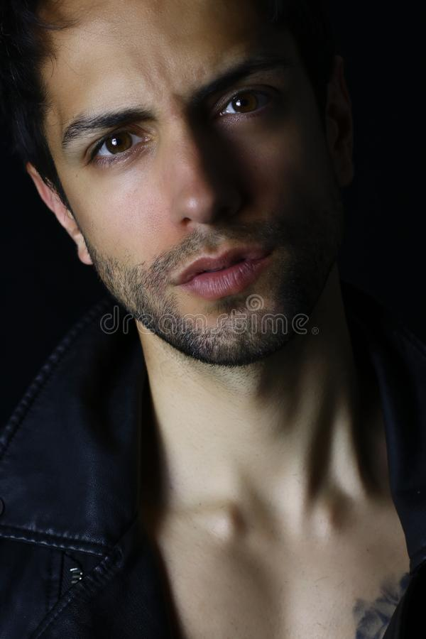 Close up portrait of an handsome man on black background royalty free stock photo