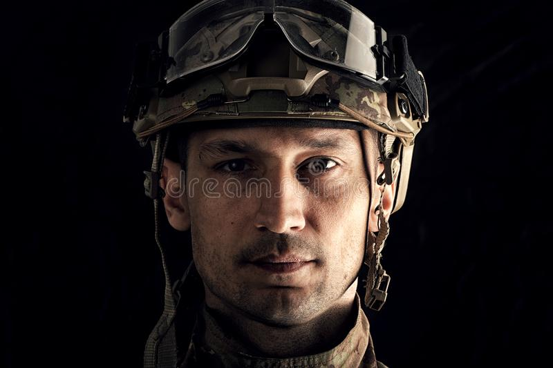 Macro view of military man. Close up portrait of handsome military man. Macro shot on black background royalty free stock photography