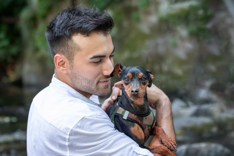 young man with dog, outdoor royalty free stock photography