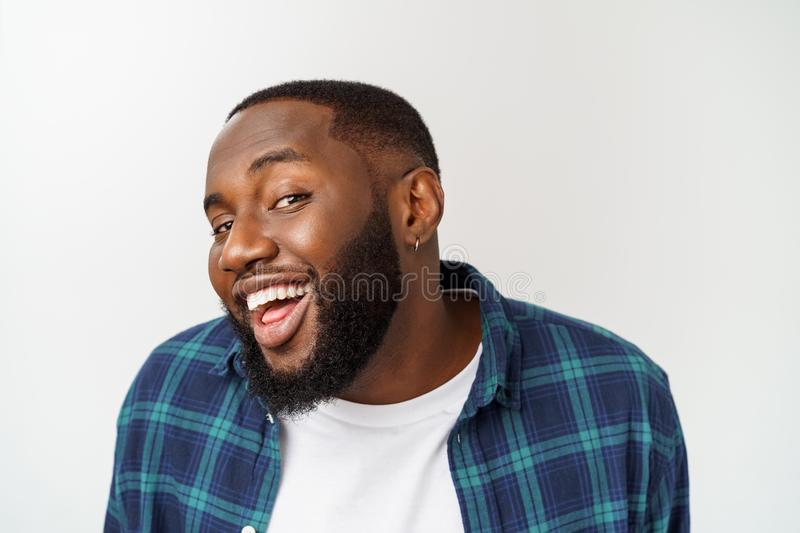Close up portrait of a handsome young man smiling. royalty free stock image