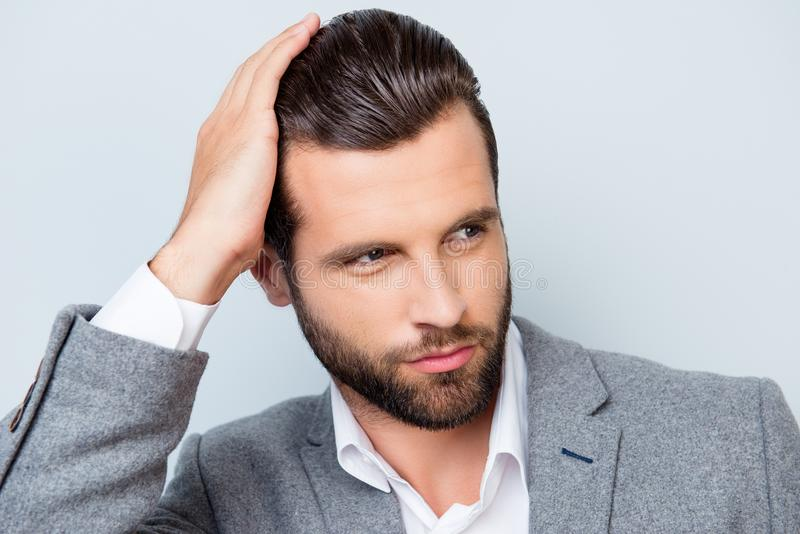 Close up portrait of handsome young man touching his perfect haitstyle stock photos